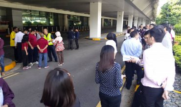 How is an Airport building Evacuation carried on?
